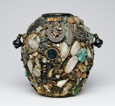 Memory Jug  Artist unknown, American    1900-1930   Earthenware, putty, glass, mirrors, seed, oyster shells