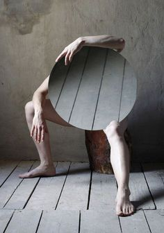 body with a round mirror in a room