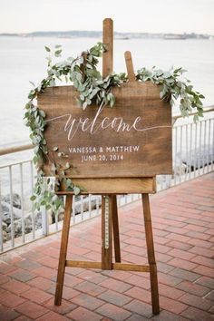 Pretty leaf garland on a rustic welcome sign