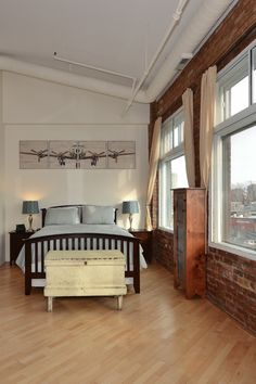 We like the exposed brick, exposed ductwork, vaulted ceilings and huge windows…