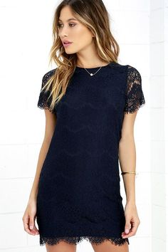 Lulus Exclusive! Perfect for many occasions, the Take Me to Brunch Navy Blue Lace Shift Dress is sure to become a staple in your wardrobe! Lively eyelash lace creates an eye-catching overlay across knit fabric through a rounded neckline, and into sheer short sleeves. Shift silhouette and scalloped hem. Hidden back zipper with clasp.