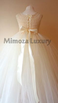 Lovely and Unique Handmade Dress, perfect for your special birthday party, wedding, christening or special occasion! The flower sash and the head piece of you choice are included!  The dress is made to order with lots of love by Mimoza Luxury designer. The dress can be customized to meet your requirements (if possible), just send me a message!  The dress bodice is hand knitted with high quality silk/cotton yarn, it feels lovely on the skin when wearing. The skirt is very fluffy made with...
