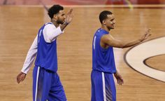 Kentucky Wildcats forward Trey Lyles and forward Willie Cauley-Stein (15) wave to the crowd after practice for the 2015 NCAA Men's Division I Championship semi-final game at Lucas Oil Stadium