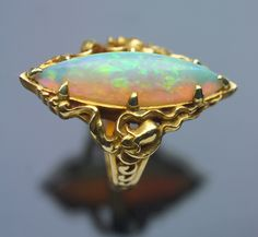 This is not contemporary - image from a gallery of vintage and/or antique objects. ART NOUVEAU  Ring  Gold Opal