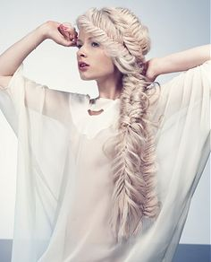 A long blonde straight coloured plaited ponytail extensions hairstyle by Inanch