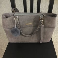 Taupe handbag This is a very lightweight handbag with a top zipper closure. Has two handles and an adjustable longer strap. Has inner center zipper pocket, two open cell phone side pockets and a zipper side pocket. Bags Satchels