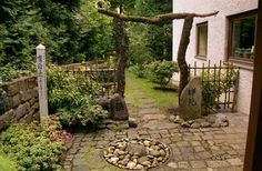 "The pole on the left in this Zen garden is a Peace Pole.  Visit ""The Peace Pole Project"" http://www.peacepoleproject.org/"