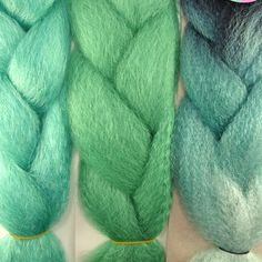 Kanekalon color comparison from left to right: Aqua, Spearmint (solid), and Spearmint (multicolored)