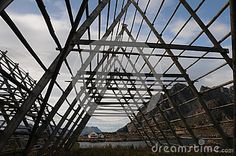 Photo about Stockfish racks in Lofoten - Norway. Image of water, mountain, triangles - 57679417 Lofoten, Triangles, Norway, Objects, Louvre, Fair Grounds, Mountain, Stock Photos, Building