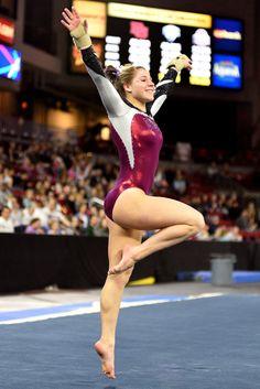University of Denver gymnast Katie Menhinick dances through her floor routine. Photo taken on March 7, 2015, in Magness Arena at DU.