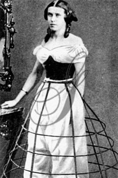 """I'm pretty sure this is an early example of photo manipulation. This looks like someone took a CDV of a woman wearing a short-sleeve open-necked bodice, and laid over it an image of cage and drawers. That's certainly not a corset she's wearing; it's a swiss waist. Her hand disappears, the angles of the hoop are awkward, and the drawers are all out of proportion to the rest of her body. The awkward cropping certainly isn't original. Any thoughts? ETA: Source is """"The Granger Collection."""""""