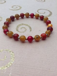 Red and orange glass beaded stretchy elasticated bracelet with