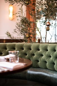 Upholstered booth seating - Design studio Fettle has showcases The Draycott; a European-inspired brasserie with a beautiful Californian twist located in Pacific Palisades, Los Angeles by acclaimed restaurateurs Matt and Marisa Hermer. #interiordesign #restaurant #bar