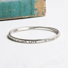 LIVE As Though Heaven Is On Earth Bangle at www.capricci.nl