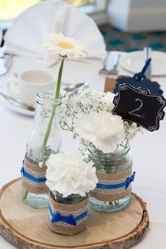Rustic and simple table centrepieces...easy, personable and saving a few pennies too!