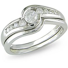 @Overstock - This shimmering bridal ring set features sweeping curves studded with icy white diamonds in channel settings. It is made with a polished 14-karat white gold finish. The total diamond weight of this set from the Miadora Wedding Collection is .5 carat TW.http://www.overstock.com/Jewelry-Watches/Miadora-14k-White-Gold-1-2ct-TDW-Diamond-Bridal-Set/4820146/product.html?CID=214117