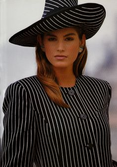 Cindy Crawford 1989. Maybe minus the hat, similar suit, centre or side button lining... We'll see ;)