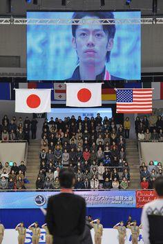 Daisuke Takahashi Photos Photos - Daisuke Takahashi of Japan listens the japanese national anthem after the men's singles during day three of the ISU Grand Prix of Figure Skating NHK Trophy at Makomanai Sekisui Heim Arena on November 13, 2011 in Sapporo, Japan. - NHK Trophy - Day 3