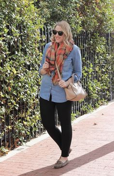 The perfect outfit to wear for Thanksgiving; black Old Navy Rockstar jeans, a chambray blouse, leopard loafers, and a Zara blanket scarf