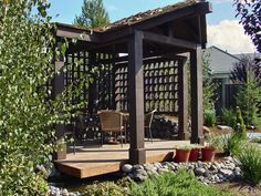 Dan Berger put a modern twist on rustic-country style when he designed this gazebo that sits alongside a babbling brook. Latticed vertical screens provide privacy and additional shade.