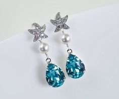 Starfish - Cubic Zirconia Starfish Earrings and Turquoise Swarovski Crystal Teardrop, Bridal, Bridesmaids Earrings, Beach Wedding Earrings by CrinaDesign73 on Etsy https://www.etsy.com/listing/227863208/starfish-cubic-zirconia-starfish