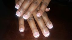 A thin pink and white acrylic overlay, call, or message me to receive  $10 off new clients.