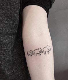Elephant family on the left inner forearm.