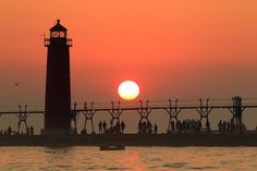 Sunset at Michigan's Grand Haven pier. Photographer-Johnny Quirin. Beautiful!