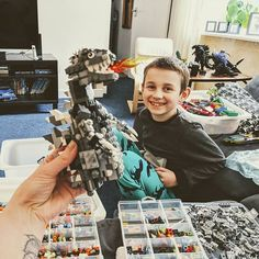 Building a @lego Godzilla for Jackson from a @YouTube tutorial total nightmare finding the 800 odd tiny pieces in amongst his thousands of pieces. Mixing dark grey light grey white and black cos we definitely don't have enough dark grey and making adjustments where we don't have the exact pieces. I'm surprised at how many of these really rare bits he actually has in abundance though. Still to make the legs and feet and I've found bits for making the head as per the tutorial since starting so…