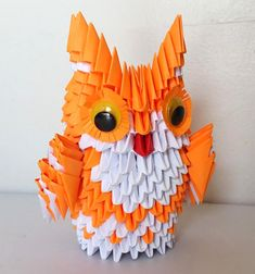This owl was made using modular origami techniques. About 400 small triangles were made and assembled. Please choose 2 colors.
