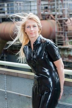 Blonde in casual black latex shirt and pants in public