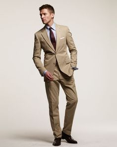 The Five Suits You Need in Your Closet    5. The Khaki Cotton Suit    A business wardrobe might consist mostly of dark suits, but spring and summer give you the chance to lighten up (literally). Do it in style with a khaki cotton suit. Pair it with a solid (blue, white, or pink) shirt and a dark tie for the office, then loosen it up (e.g., lose the tie and socks) for an evening out. Click on the NEXT button below for the season's best khaki cotton suits, in three price points.