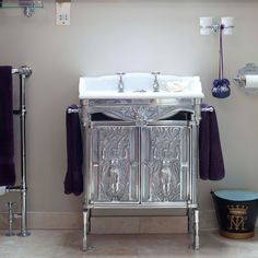 Step inside a glamorous converted church-   Silver washstand:   This ornate metal washstand is another statement piece in the unique bathroom. Purple hand-towels coordinate with the colour scheme. Hadn't thought of using purple as an accent color.