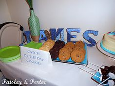 """Catch of the Day Cookies"" on nautical themed baby shower dessert table"