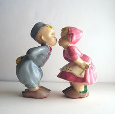Dutch Girl Dutch Boy Vintage Chalkware Figurines Kitsch Kissing - these very items are in my mom's house.