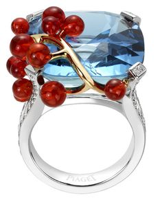 Aquamarine set in white gold, with a yellow gold Fire Opal berry branch.