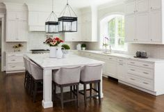 Off white Kitchen cabinets with gray backsplash tile. Off white Kitchen cabinets with gray backsplash tile ideas. Off white Kitchen cabinets with gray backsplash. #Offwhite #Kitchen #cabinets #graybacksplash #graybacksplashtile Martha O'Hara Interiors
