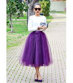 Purple tulle skirt worn casually with sweater and pumps.