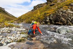 ASC adventure scientists sampling microplastics in river