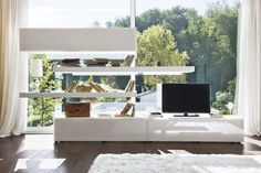 Air is a free-standing wall unit that lets you furnish the living room without attachment restrictions, adding movement and rhythm to the interior.
