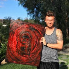 """Here he is with his second painting ever. It's called """"Bearing Mothers Pain"""" and a portion of the proceeds went to children's cancer research."""