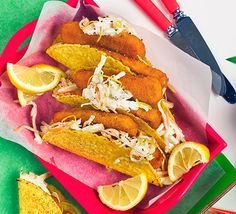 Knock up this quick party snack using fish fingers, corn shells and a fennel coleslaw