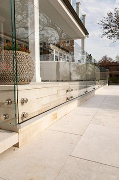 Jerusalem limestone patio, with cool glass divider.