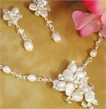 Freshwater Pearl Necklace Set for the Bride Elegant necklace for the bride to wear on her wedding day and special occasions and event thereafter. Silver plated necklace and earring set features ivory freshwater pearls, clear rhinestones, and Swarovski crystals. This elegant design is a beautiful choice for a wedding or special occasion and will coordinate beautifully with any dress. The necklace features a lobster claw clasp.