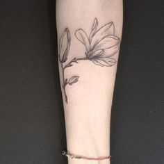 Grey Inked Magnolia Flower Tattoo. An outline of the magnolia flower looks perfect on forearm.