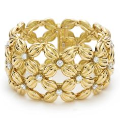 Tiffany & Co from Jean Schlumberger - His Signature of Chic collection - the Daisy bracelet gold with diamonds set in platinum) Gold Jewelry, Jewelry Accessories, Jewellery, Flower Jewelry, Flower Rings, Yellow Jewelry, Fashion Accessories, Daisy Bracelet, Bangle Bracelet