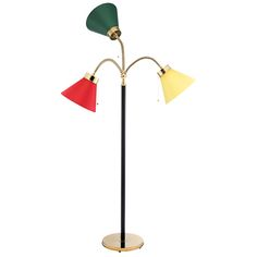 """Floor lamp 2431. This lamp is black lacquered with a brass foot. It was designed by Josef Frank in 1938 and called """"the three spirals"""". This lamp was in the Golden Gate Exhibition in San Francisco in 1939 and since then it has been referred to as """"the San Francisco"""" lamp."""