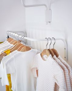 Close-up of children's clothes hanging on MULIG clothes bar