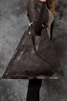 Gorgeous oversized leather triangular bag