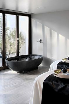 amazing bathtub in a room i could probably spend hours in.   stylish black by the style files, via Flickr